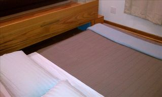 Queens studio photo - Queen Tempur-Pedic Bed is Rolled Out from Inside the Platform.
