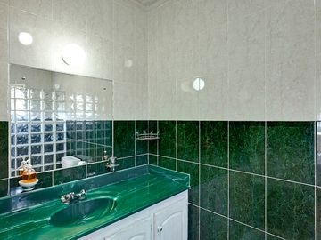 Fully tiled bathrooms, with Decoran counter-tops