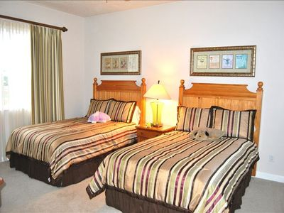 Full size twin beds in this bedroom