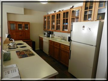 Well-stocked remodeled kitchen for cooking in and keeping food costs low.