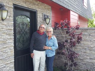 Front entry with 2 of our first guests that sent us a thank you and their photo! - Temecula house vacation rental photo