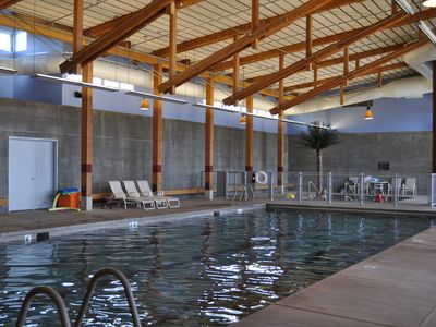 Indoor pools; gated wading pool for the youngest of guests in the background.