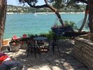Enjoy a relaxing vacation on a shady hammock overlooking Lake Travis