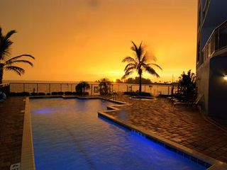 Cocoa Beach condo photo - Large heated swimming pool and hot tub for your pleasure!