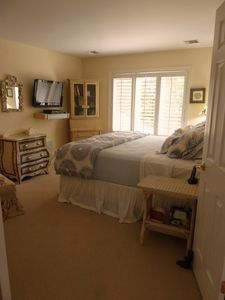 Private Master suite w/ flat screen, king bed, plantation shutters, wall to wall