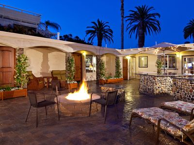 Private Entertainment courtyard w/ ample seating areas, BBQ Bar & cozy firepit.