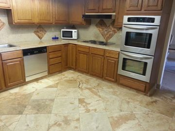 Kitchen, all SS including Side by Side Frig. Granite counters, travertine floors