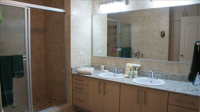 Master bathroom with large shower, 2 sinks, lots of counter and storage space.