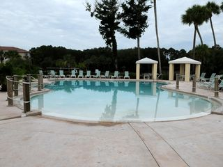 Palm Coast condo photo - Large Pool with Kids Splash Zone and BBQ Grills