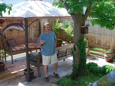 privacy fenced backyard; lighted gazebo with summer outdoor kitchen and bar