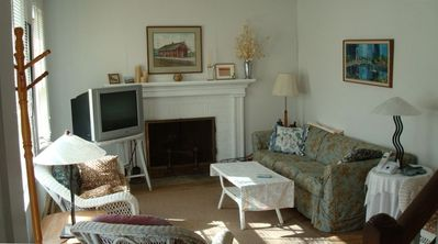 living room with fireplace and TV with premium cable