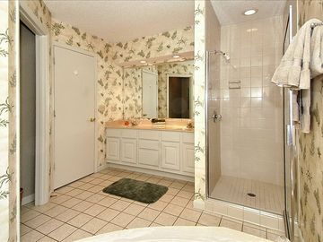Master bath offers separate tub and walk-in shower