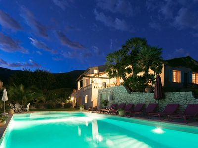 Night View of Pool, House and Mountains