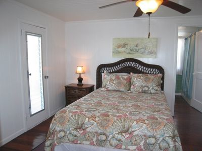 Queen Bedroom - paddle fan and door to front porch - ocean views.  Ground floor.
