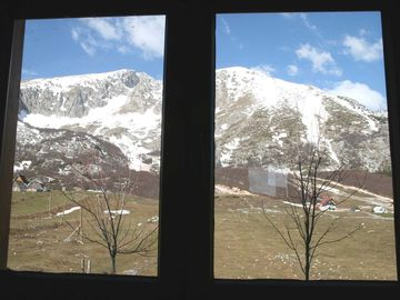 View of mountain through dining area window 2/11