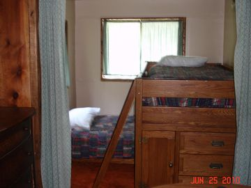 Bedroom on lower level off dining area w/ twin bunk beds