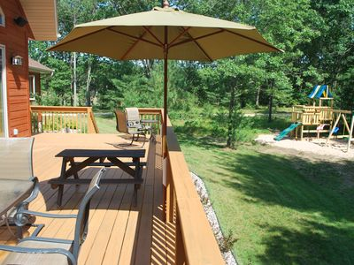 Deck is close proximity to play area for easy child supervision