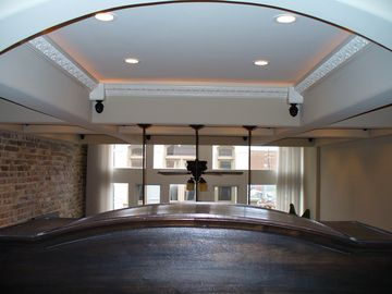 Coffered ceiling w/ Baroque crown moulding and remote controlled lighting
