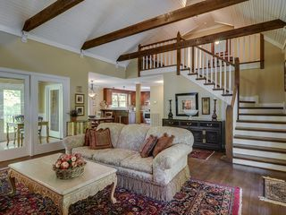 Franklin house photo - Vaulted ceiling with exposed beams. Staircase leads to two bedrooms and bathroom