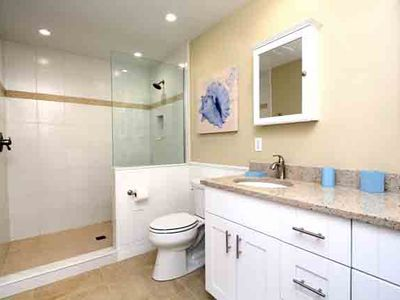 New bath off game room-huge shower, double granite vanity-wheel chairs can fit!