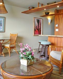 The living room and kitchen are reflective of the Hawaiian plantation region.