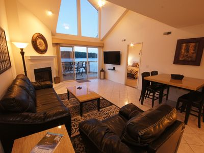 Osage Beach condo rental - Living Room featuring 46 inch TV & Fireplace with 2-Story Windows & Lake View