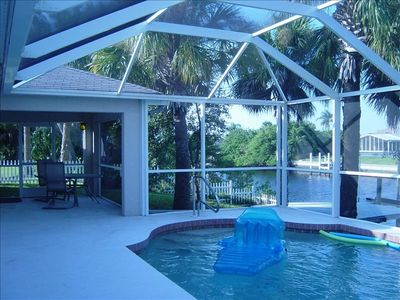 Pool & Lanai over looking dock area & canal
