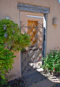Wrought Iron Gate leads to Entrance Courtyard