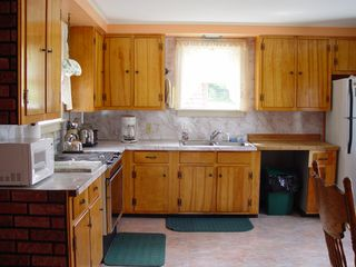 Eastbrook cottage photo - Full kitchen with jennair stove, fridge, microwave, toaster , all utensils etc.