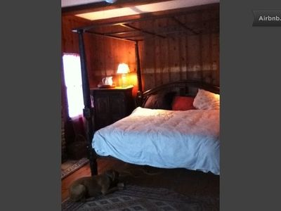 Master bedroom, just off the kitchen. Has a wood burning stove, table/chairs