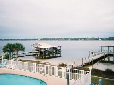 view of bay and pool from downstairs deck