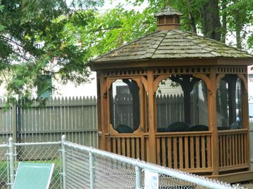Screened-in gazebo for your personal use.