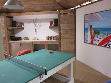 Rec room with ping pong table.