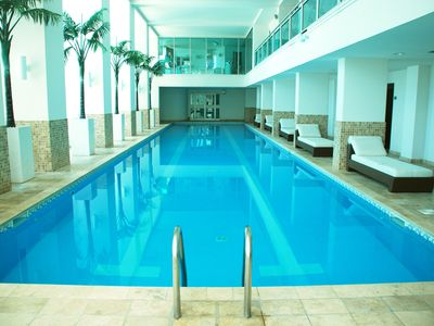 Indoor lap pool area with hot tub, steam rooms, and saunas!