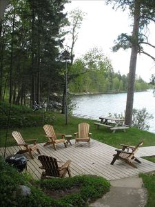 Our deck overlooks the lake. A hammock is nearby, as is our log sided firepit.