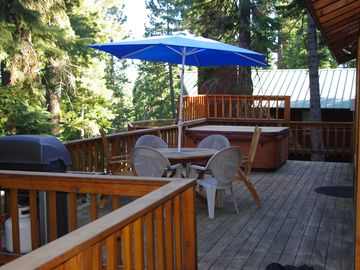 Private deck with hot tub overlooking forest with peek views of Lake Tahoe & bbq
