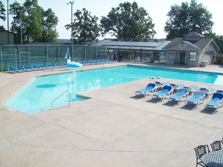 Branson condo photo - Large outdoor pool with plenty of lounge chairs around the deck