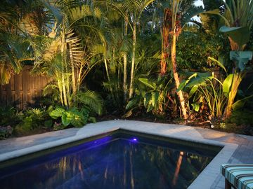 Beautifully lit pool deck at night