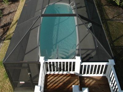 View of the enclosed pool from the top balcony.