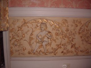 Newport chalet photo - Detail in the Billiard Room. 3 dimensional plaster figures and golden accents.