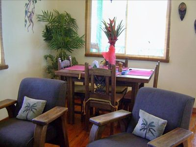 The living room and dining are decorated with a tropical feel.