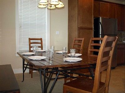 Dining area. Upscale hardwood furnishings.