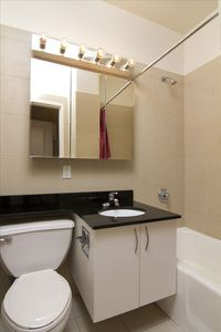 Full bathroom with shower and bath tub