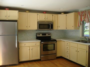 Chef's kitchen with new Frigidaire stainless appliances