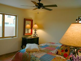 King bed in large second bedroom w privacy shades - Taos house vacation rental photo