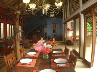 Sanur house photo - View of main room from dining table. Bedrooms are at far end and upstairs.