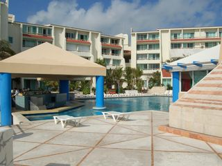 Cancun condo photo - Pool and swim up bar with complex behind it