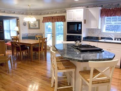 Kitchen & dining area will seat 10 people comfortably. 2 refrigerators in home.