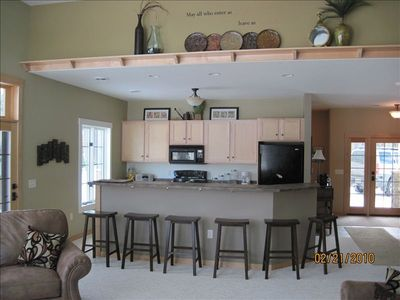 Maple cabinets and wood floor. Fully Equipped Kitchen w/Bar Seating