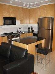 Vancouver apartment photo - Kitchen with Fridge, Gas Stove, Microwave and Dishwasher